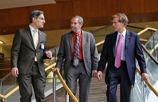 Doug Lowy, MD, (middle), the acting director of the National Cancer Institute, talks with UK College of Medicine Dean Robert DiPaola, MD, (left) and UK Markey Cancer Center Director B. Mark Evers, MD, during his visit to UK HealthCare in October 2016.
