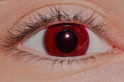 Alexis Johnson wears red contact lenses.