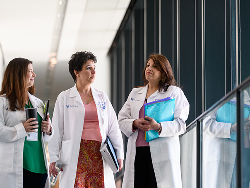Left to right: Bethany Taylor, RT(R); Liliana Terziyska-Kuvlieva, MD and Omyma Sorour, MD talk.