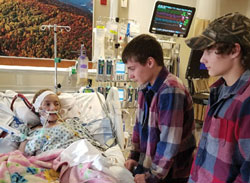 Brothers Hunter and David Jessie visit their sister Breanna in the hospital.