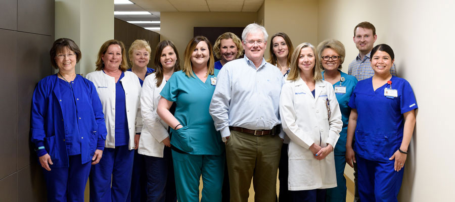 Dr. Tom McLarney with his colleagues.