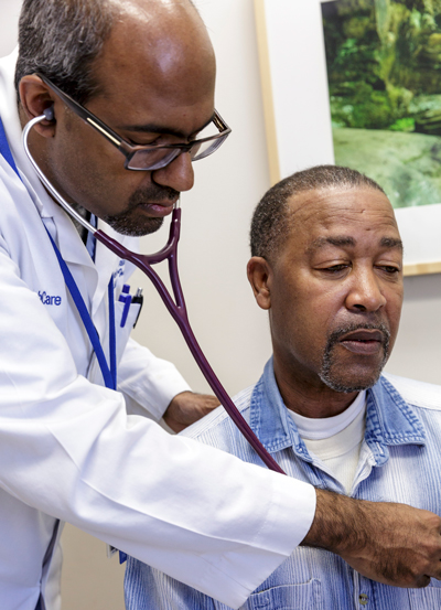 Dr. Navin Rajagopalan listens to Joe Madison's heart.
