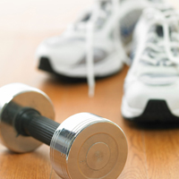 A dumbell (weight) and athletic shoes.