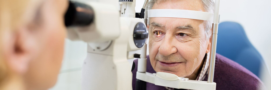 Man getting eyes examined