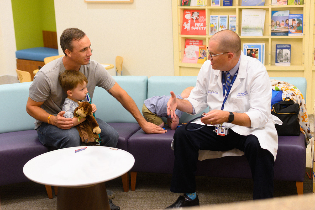 Ezra and Arlo Yost with their father and Dr. Erich Maul.