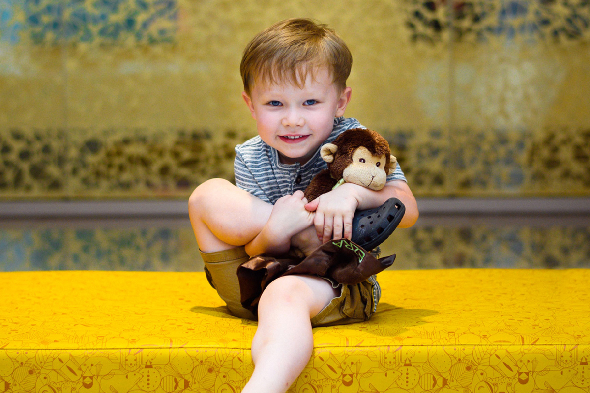 Ezra Yost holds tight to his monkey puppet.