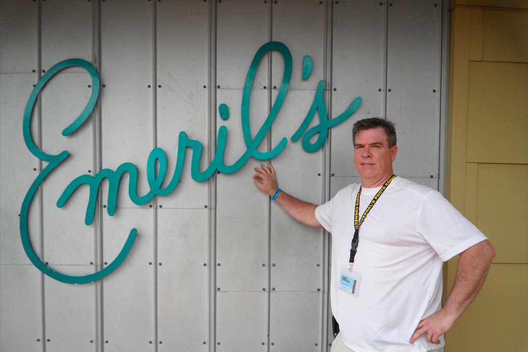 Fred Wohlstein poses for a photo in front of Emeril's Restaurant.