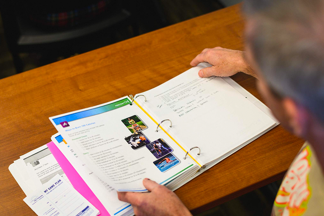 Fred Wohlstein looks through a binder of information from his diabetes education class.