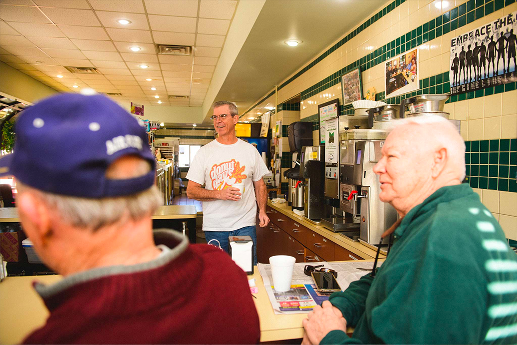 Fred Wohlstein waits on customers at his bakery.