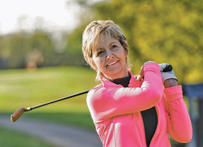 Geri McDowell swings a golf club.