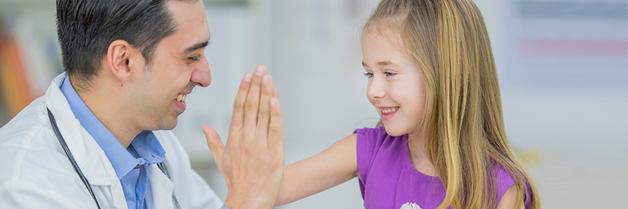 Girl giving a doctor a high-five