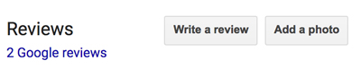 "Screen capture of Google's ""write a review"" button"
