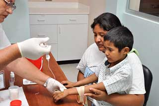 Child receiving hemophilia treatment