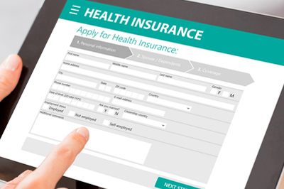 An insurance form is seen on a tablet.