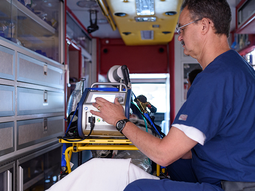 A technician is seen inside the ECMO transport unit.