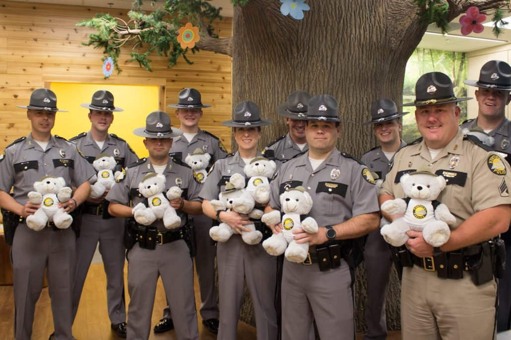 Kentucky State Troopers deliver teddy bears to Kentucky Children's Hospital patients.