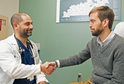 Dr. Andrew Leventhal greets a patient.