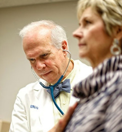Lowell Anthony listens to Geri's heart during a followup visit. Read her story »