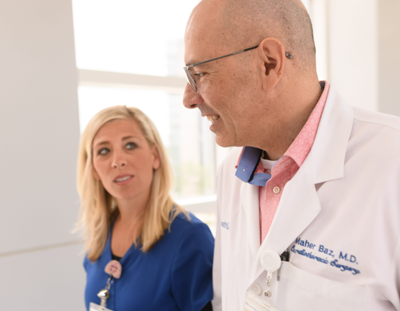 Dr. Maher Baz talks with a staff member.