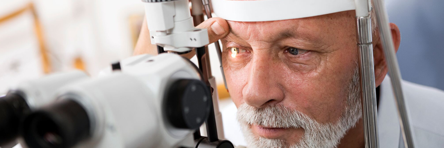 Man getting his eye's examined