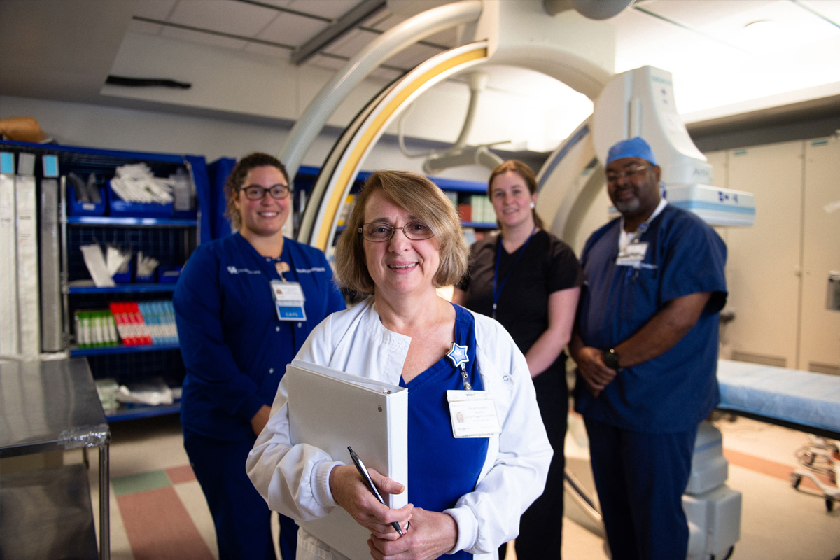 Margie Cooper with radiology staff.