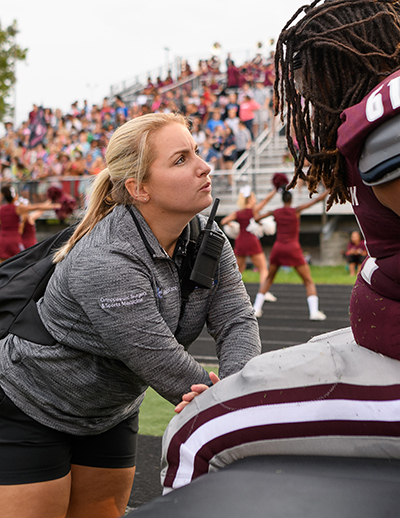 An athletic trainer talks with a Tates Creek Senior High School football player.