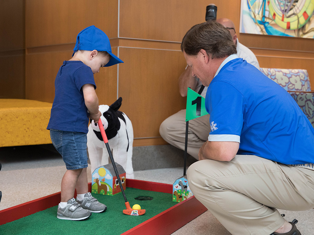 A young patient putts.
