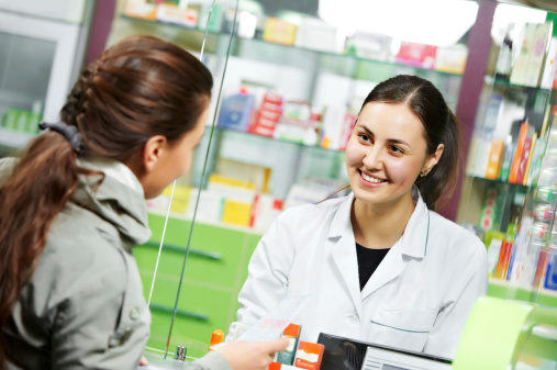 Pharmacist talking with patients