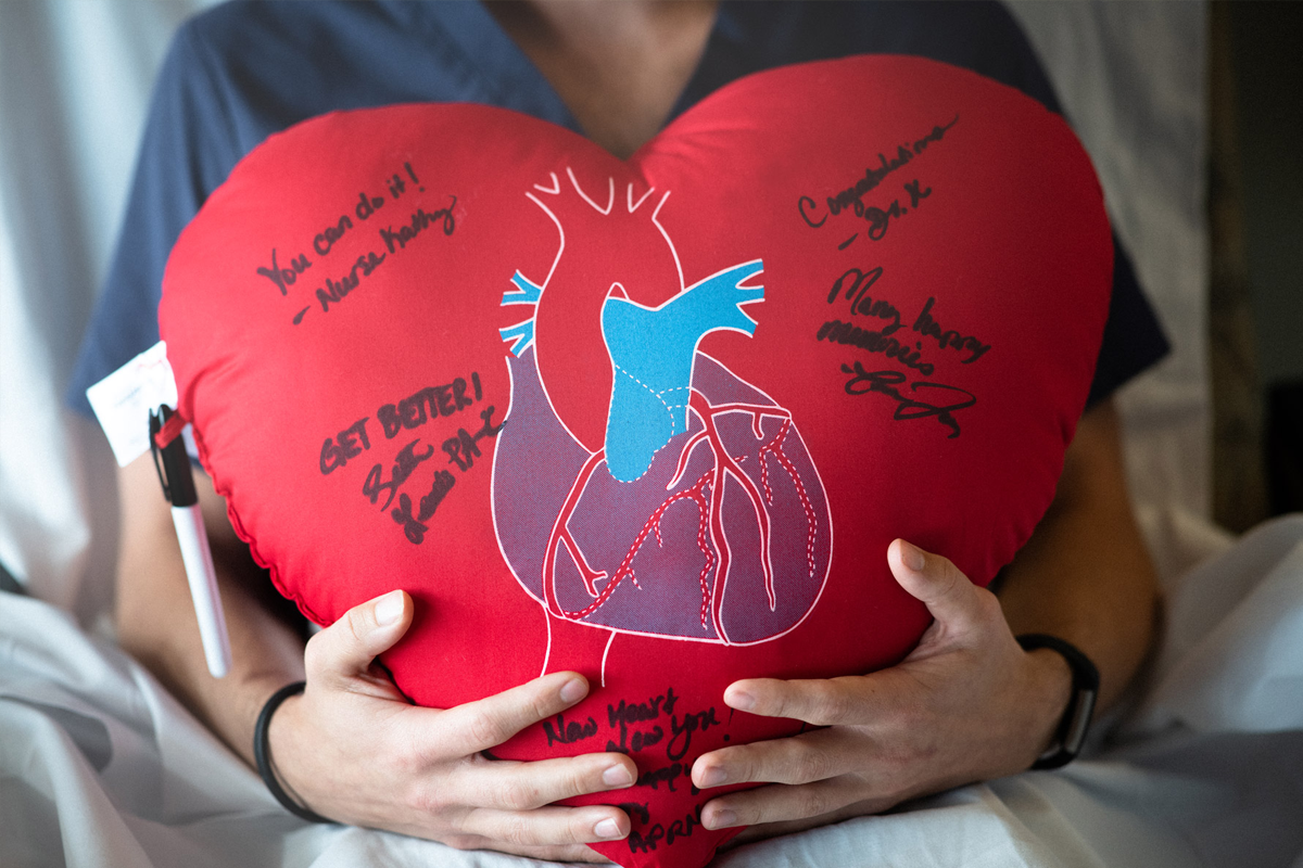 An autographed, heart-shaped pillow given to patients in Joy Coles' unit.