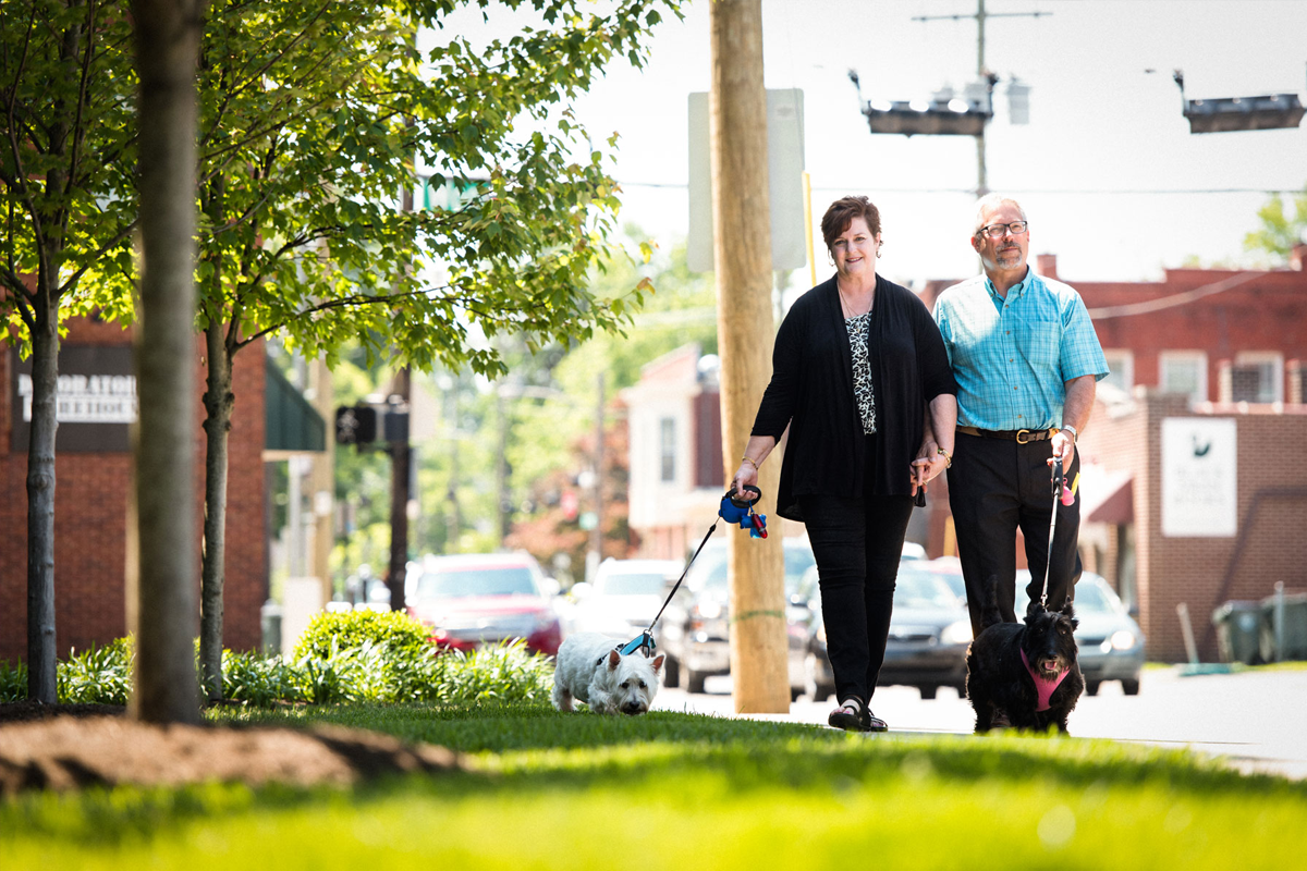 Teresa and Tom Schladt walk their dogs.