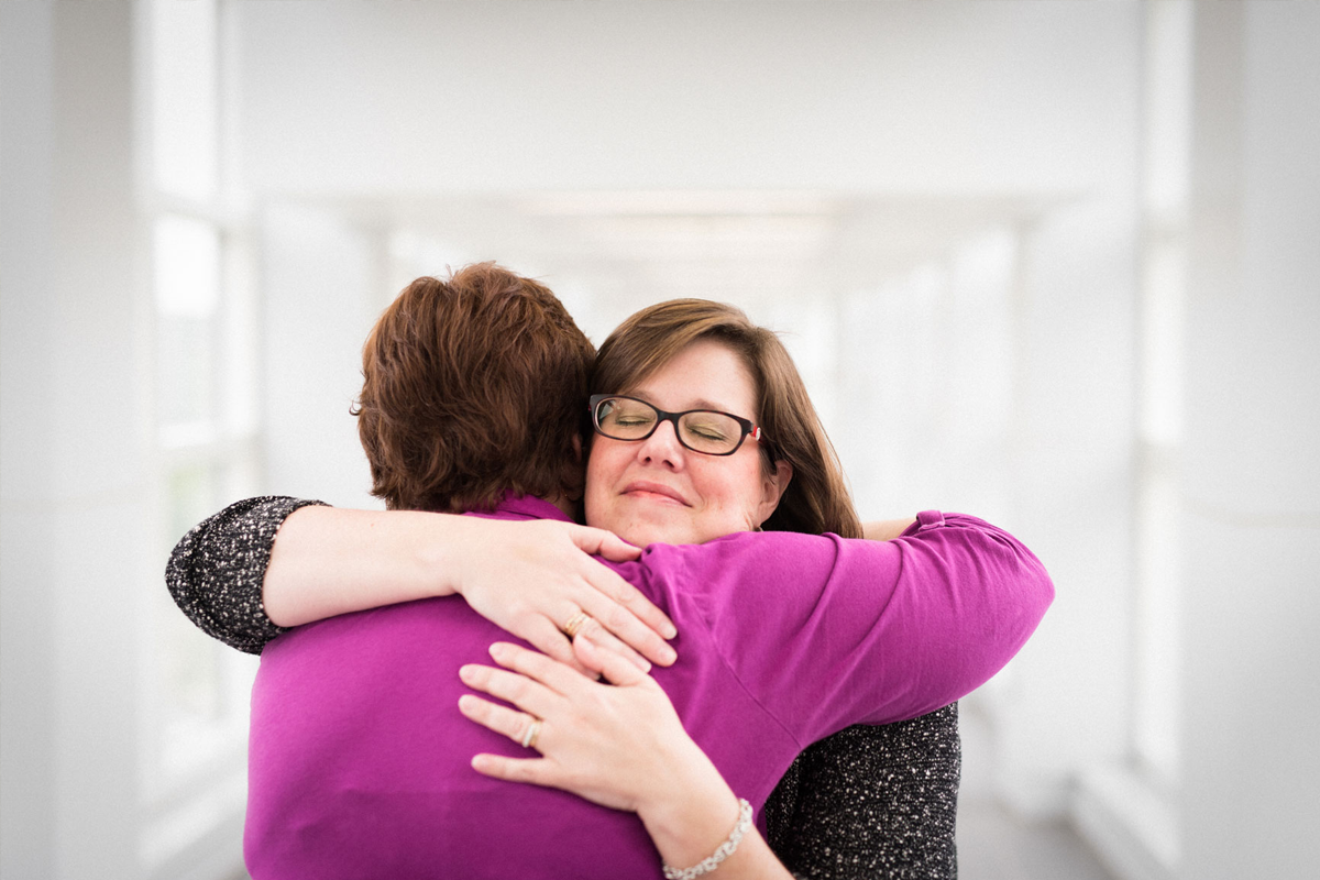 Teresa Schladt and Jennifer Watkins share a hug.