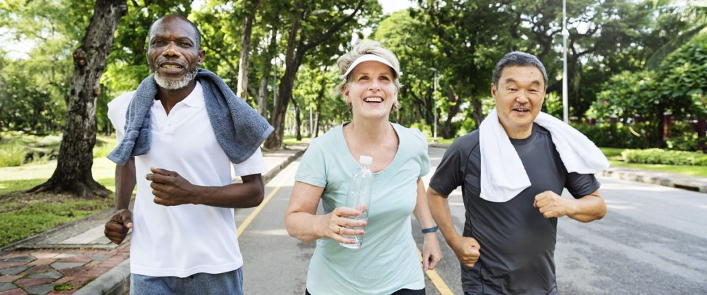 Three people running for exercise.