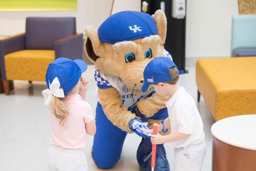 "Mascot Scratch gives a patient ""five."""